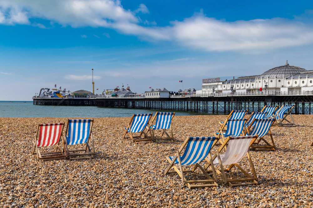 A shot of Brighton Pier from the pebbled beach